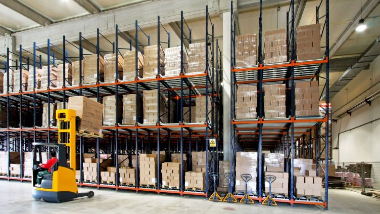 3326853 - yellow fork lifter work in big warehouse